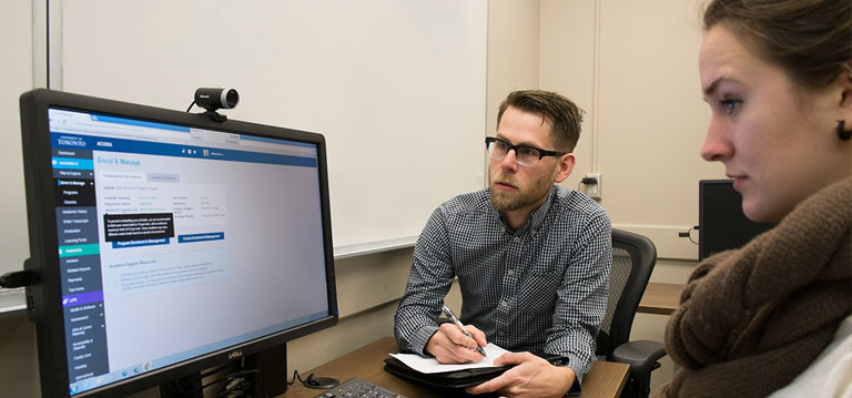 User experience designer watches student go through usability test