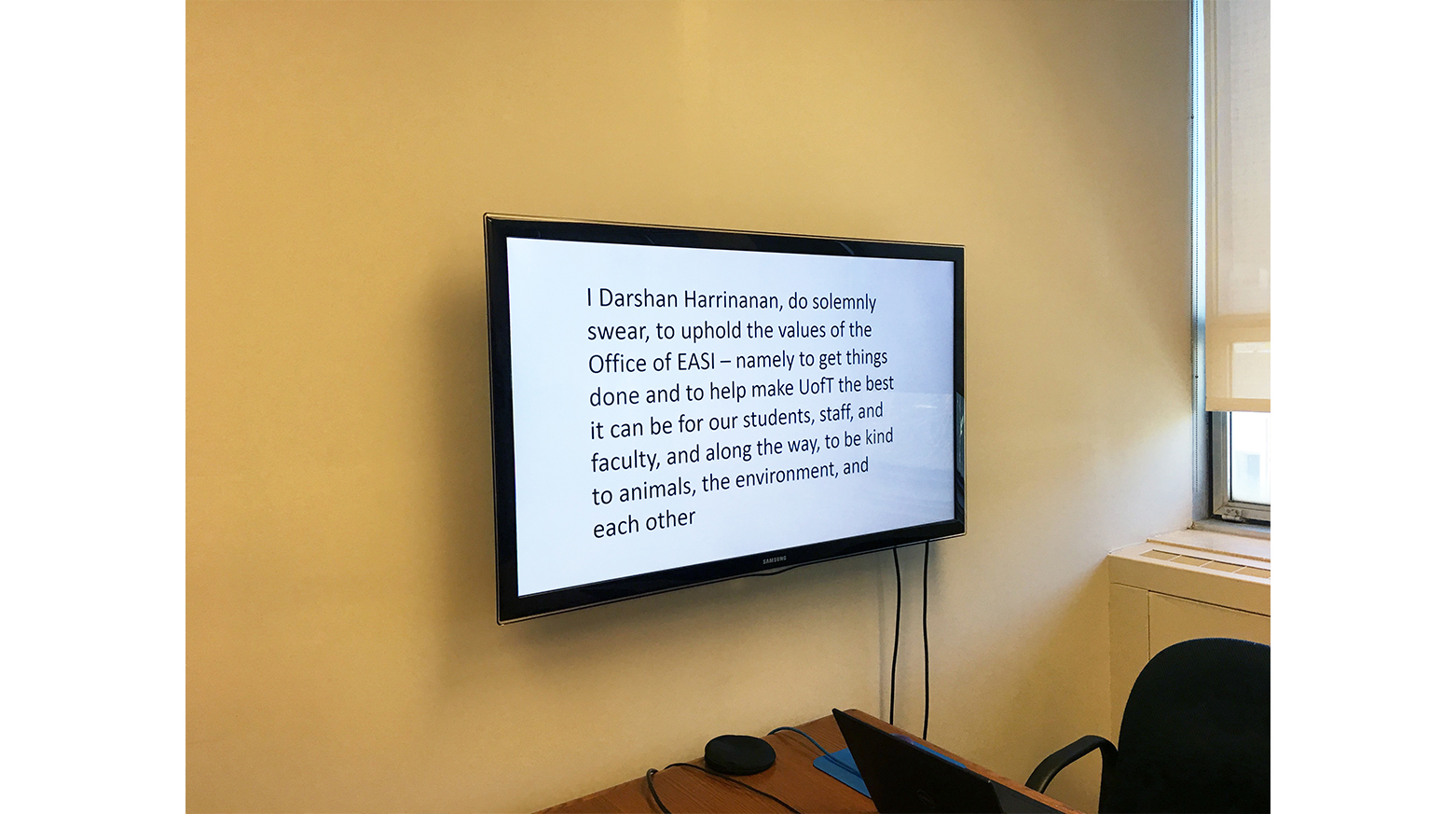 The oath that Darshan Harrinanan takes is displayed on a screen