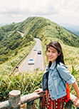 Tiffany Kao posing in front of a road and mountains