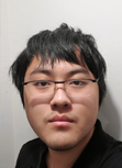 Yuting posing for a headshot while wearing glasses and a black shirt